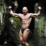 Muscled male model posing outdoors Royalty Free Stock Photos