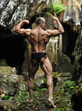 Muscled male model posing outdoors Royalty Free Stock Photo