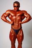 Muscled male model posing in studio Stock Photo