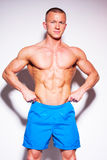 Muscled male model posing in studio. Royalty Free Stock Photography