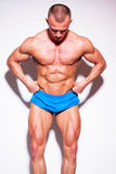 Muscled male model posing in studio. Royalty Free Stock Photos