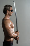 Muscled Male Model In Studio With A Sword Stock Photos
