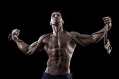 Muscled man on a black background Stock Photos
