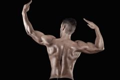 Muscled man on a black background Stock Photo