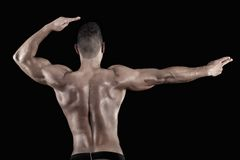 Muscled man on a black background Royalty Free Stock Photo