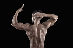 Muscled man on a black background Royalty Free Stock Image