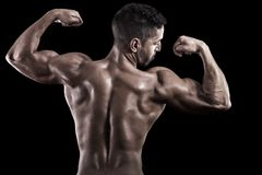 Muscled man on a black background Royalty Free Stock Images