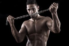 Muscled man on a black background Royalty Free Stock Photography