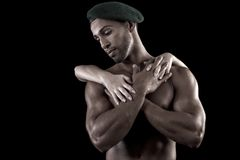 Muscled man on a black background Royalty Free Stock Photos