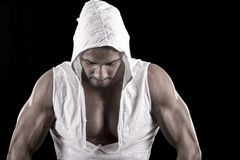 Muscled man on a black background Stock Photography