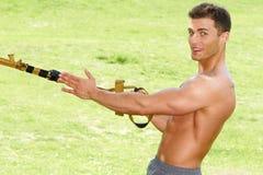 Muscled Man Exercising While Pulling Something Stock Image