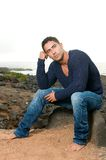Muscled man with pullover Royalty Free Stock Photos