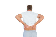 Muscled man suffering from back pain Stock Photo