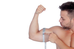 Muscled man with tape measure. Isolated on a white background Stock Photography