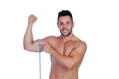 Muscled man with tape measure Royalty Free Stock Photo