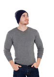 Muscled man with wool hat looking up Stock Photos