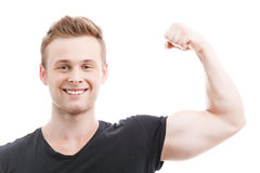 Muscled man during workout Stock Images