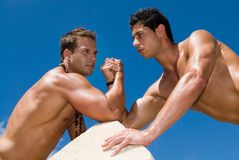 Muscled men body under the blue sky Royalty Free Stock Photo