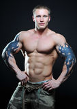 Muscled model with tattoo Stock Image