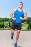 Muscled sportsman during training Royalty Free Stock Photo