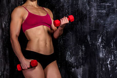 Muscled woman with barbells Royalty Free Stock Image