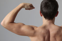 Muscles. Young man with big muscles Stock Photo