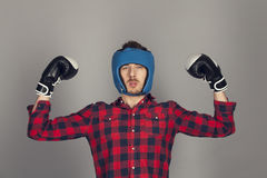 Muscles fashionable boxer in the red shirt Stock Photos