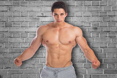 Muscles flexing posing bodybuilder bodybuilding strong muscular. Young man Stock Photo