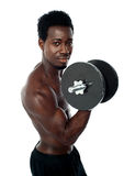 Muscular african guy doing biceps exercise Stock Photos
