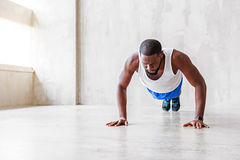Muscular african guy doing exercises Stock Photo