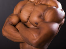 Muscular african man body. Closeup Royalty Free Stock Photography