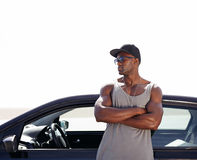 Muscular african man standing by his car Stock Photography