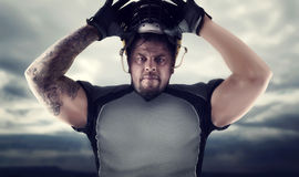 Muscular american football player against dark sky Stock Photos