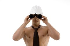 Muscular architect looking through binocular Stock Photos
