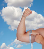 Muscular arm of a man's biceps measure yourself Royalty Free Stock Photography