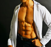 Muscular asian businessman Stock Photo