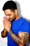Muscular Asian Male Praying Stock Image