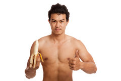 Muscular Asian man with banana show thumbs up Stock Images