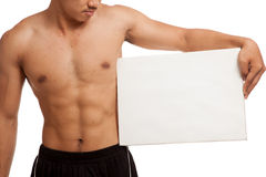 Muscular Asian man with blank sign Stock Image