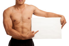 Muscular Asian man with blank sign Royalty Free Stock Photo