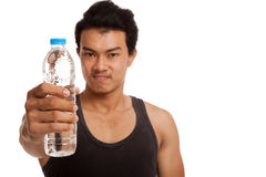 Muscular Asian man with bottle of water Stock Photos