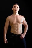 Muscular Asian man in dark jeans Royalty Free Stock Photography