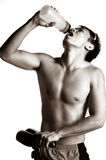 Muscular asian man drinking Royalty Free Stock Photo