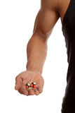 Muscular Asian man with drug pills. Isolated on white background Stock Photo