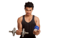 Muscular Asian man with dumbbell and whey protein shakes Stock Photography