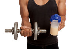 Muscular Asian man with dumbbell and whey protein shakes Royalty Free Stock Images