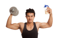 Muscular Asian man with dumbbell and whey protein shakes Royalty Free Stock Photography