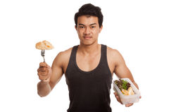 Muscular Asian man eat clean food in box Royalty Free Stock Photo