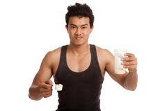 Muscular Asian man eat whey protein shakes Royalty Free Stock Photography