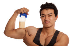 Muscular Asian man  flexing biceps with whey protein shakes Stock Image